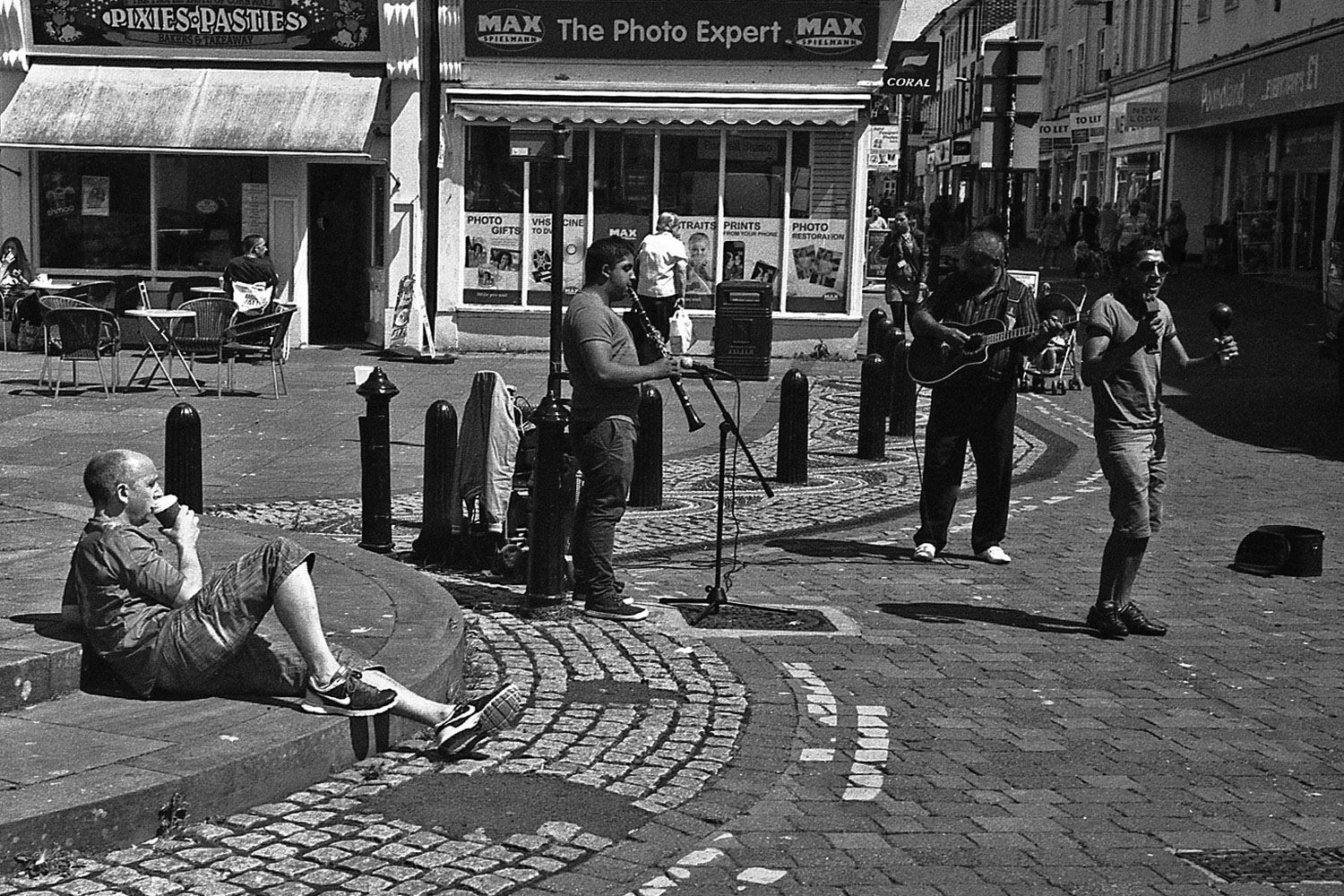 musicians and relaxing with coffee whitehaven street photography uk photographer kevin shelley prints for sale leica m2 jupiter 8 50 f2