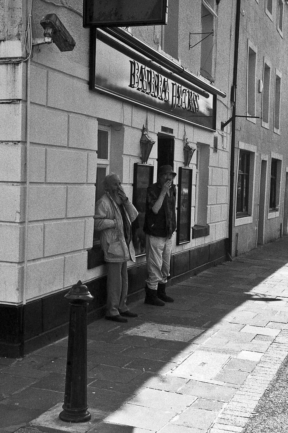 two men smoke outside pub whitehaven street photography uk photographer kevin shelley prints for sale leica m2 jupiter 8 50 f2