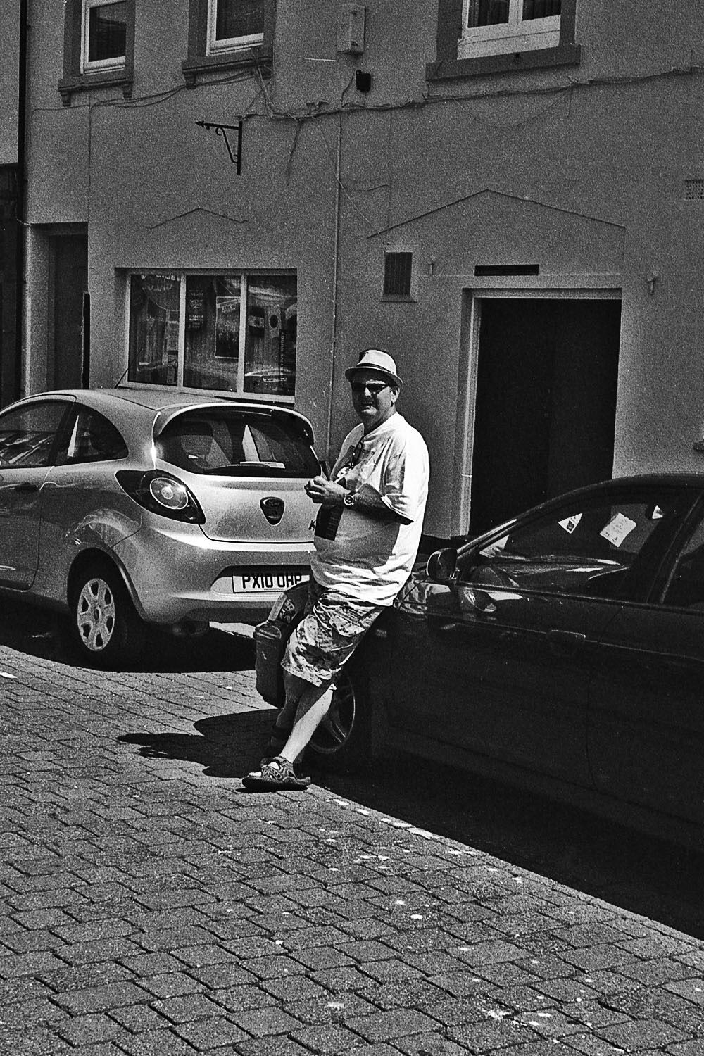 man leans against car whitehaven street photography uk photographer kevin shelley prints for sale leica m2 jupiter 8 50 f2