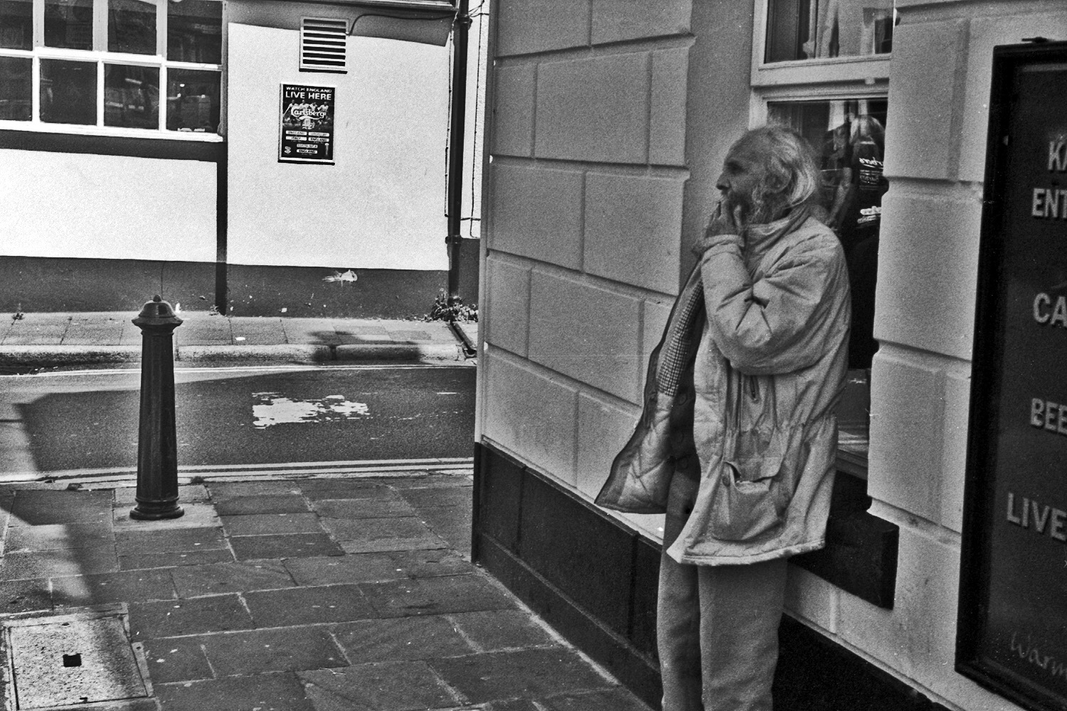 man smokes outside pub whitehaven street photography uk photographer kevin shelley prints for sale leica m2 jupiter 8 50 f2