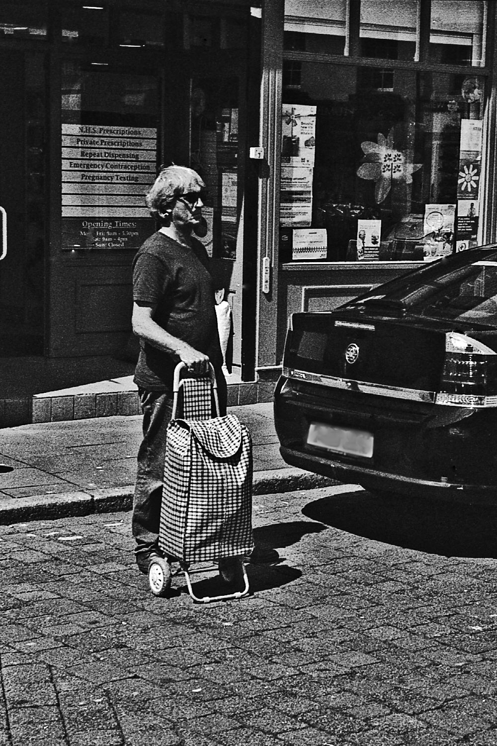 man with tartan trolley whitehaven street photography uk photographer kevin shelley prints for sale leica m2 jupiter 8 50 f2