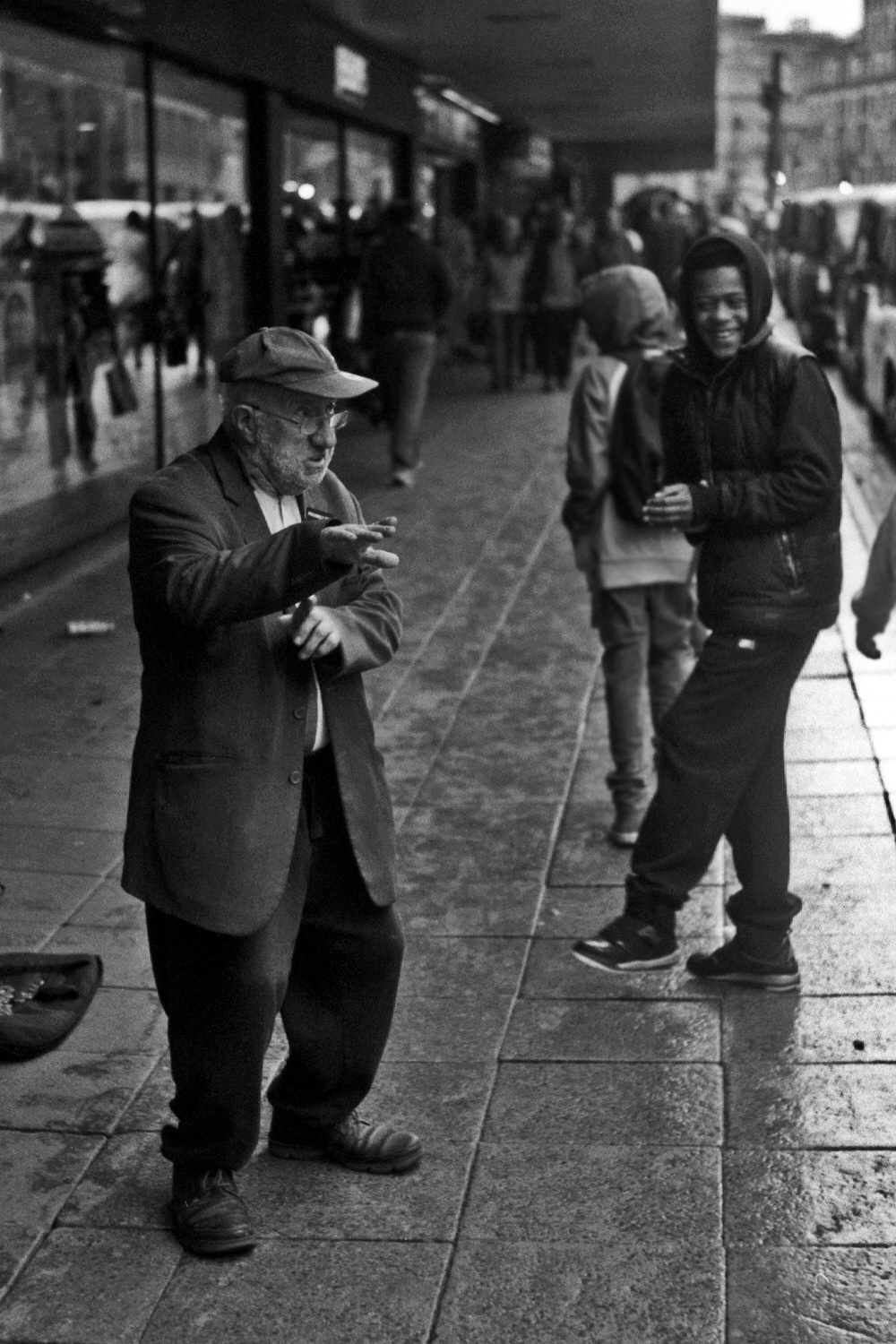 old man rave dancing in manchester whilst young lad cheers him on street photography uk photographer kevin shelley prints for sale leica m2 jupiter 8 50 f2