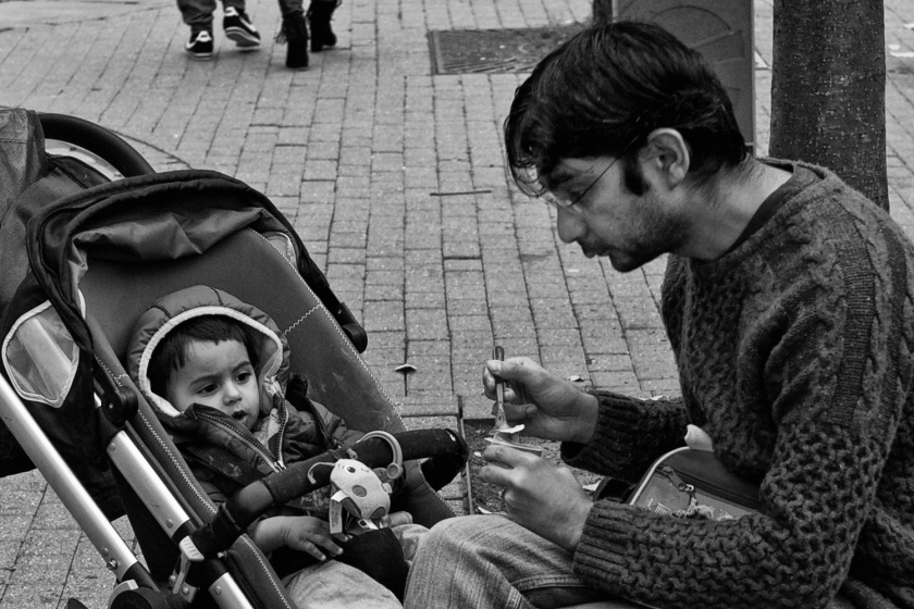 A Father Feeds His Infant Son in Chester Street Photography Leica M9 M-E