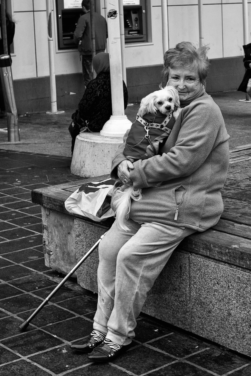 old woman liverpool cuddles dog love street photography leica m9 m-e