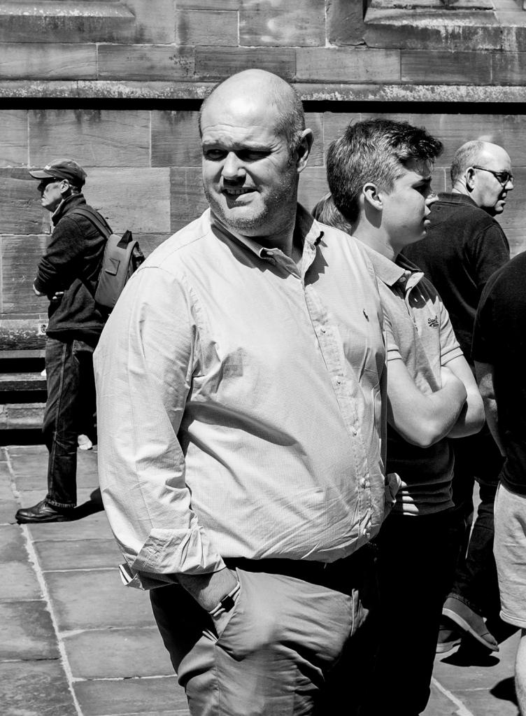 chester uk man looks around street photography blog