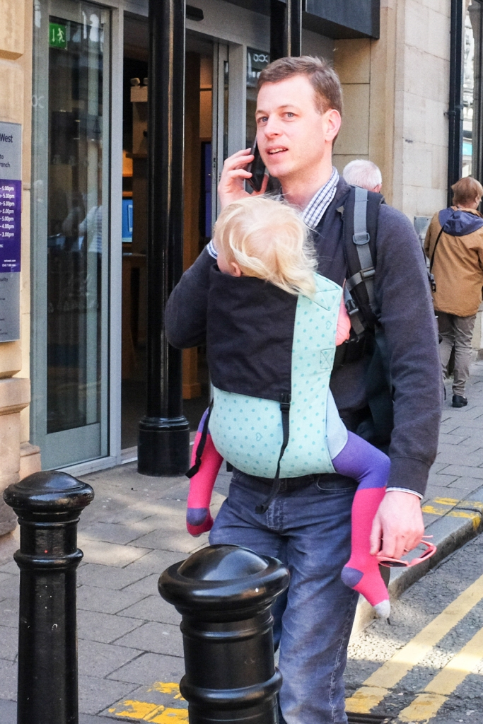 chester street photography man on phone with baby in sling kevin shelley fuji x100t